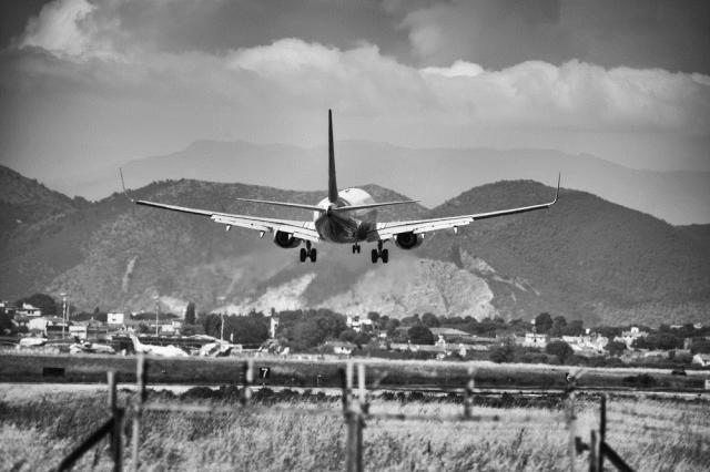 A Plane Lands at Pisa International Airport, in the Heart of Tuscany. pisaphotography / Shutterstock.com